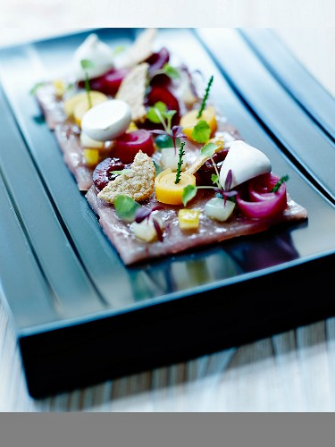 Raw marinated tuna ceviche, stewed vegetable and mozzarella ball salad