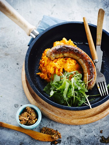 Rustic sausage,pureed carrots and rocket lettuce salad