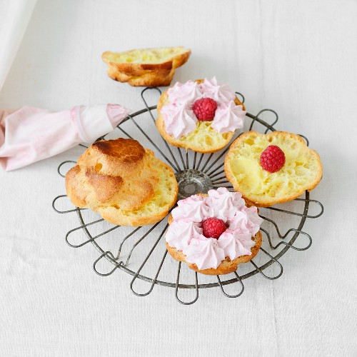 Filling the puff pastries with the raspberry mascarpone cream