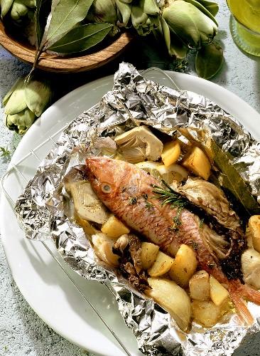 Triglia al cartoccio (red mullet cooked in foil, Italy)