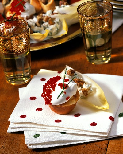 Red Caviar Blini with Walnut Costello Blue Cheese on Endive
