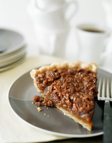 Piece of pecan pie with coffee (USA)