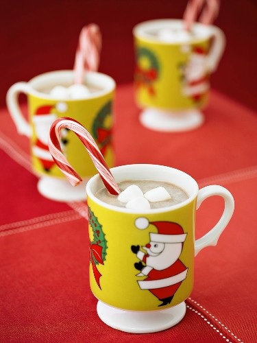 Hot Chocolate in Christmas Mugs with Candy Canes and Marshmallows