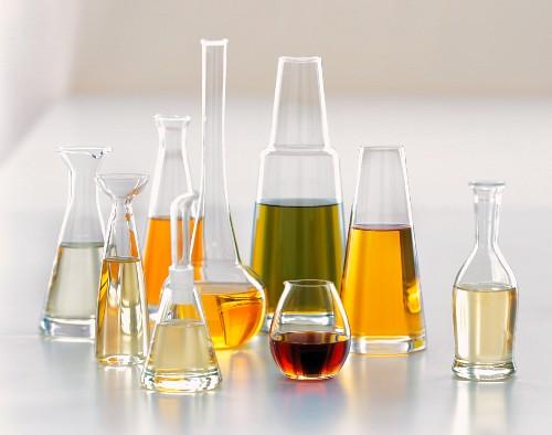 Nine Glass Jars of Assorted Oils