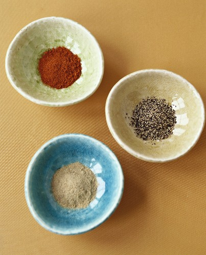 Small bowls of pepper and paprika