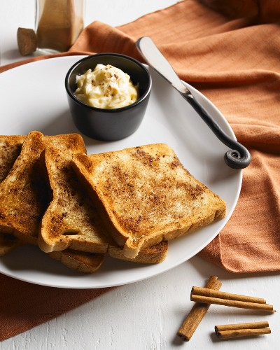 Cinnamon Toast Slices on a Plate with Cinnamon Honey Butter, Knife