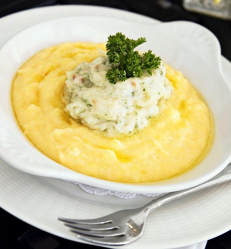 Bowl of Polenta Topped with Cod and Curly Parsley, Fork