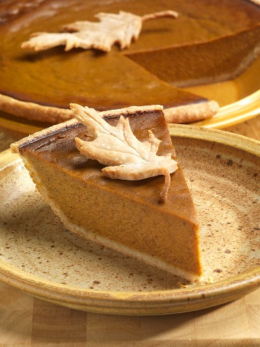 Slice of Pumpkin Pie with Pastry Leaf Garnish