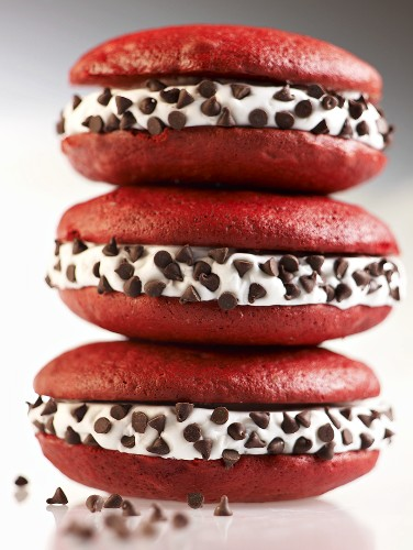Three Red Velvet Whoopie Pies with Chocolate Chips Stacked