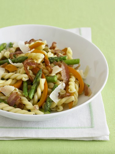 Gemelli Pasta with Veggies and Prosciutto in a White Bowl