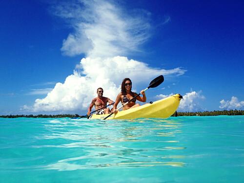 Couple in a kayak, Bora Bora, Society Islands, French Polynesia, Windward Islands, South Pacific