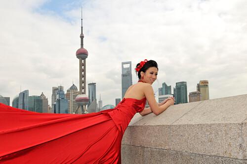 Bride in wedding dress, Bund, Oriental Pearl Tower, Shanghai, China