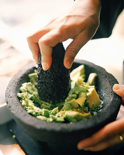 MEXICO, Mexico City, person making guacamole in molcajete, close-up at the W Hotel.