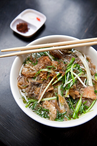 VIETNAM, Hanoi, traditional street food restaurant called Quan An Ngon, Beef Noodle bowl, Banh Ota Ca