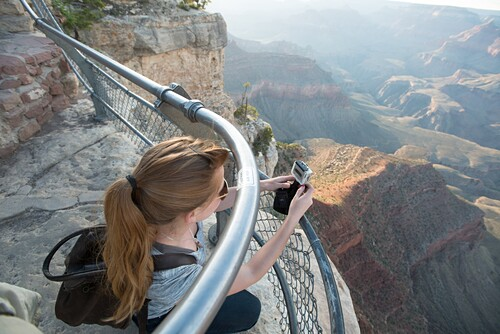 young woman documenting the Grand Canyon.