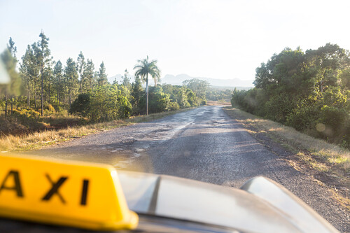 empty road to through the Cuban countryside from Vinales to Cayo Levisa, taxi, family travel to Cuba, parental leave, holiday, time-out, adventure, Cayo Levisa, day trip from Vinales, Pinar del Rio, Cuba, Caribbean island