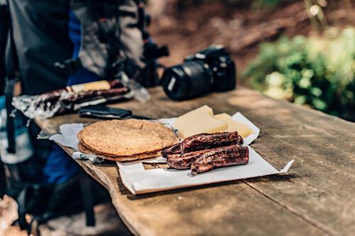 Hiker preparing lunch at Ehrwalder Almsee, Reutte, Tirol, austria, europe.