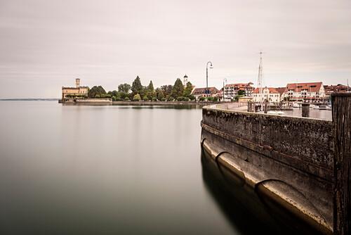 pier at harbor with view at Montfort castle, Langenargen, Lake Constance, Baden-Wuerttemberg, Germany