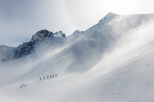 Group of skiers ascending untracked snow slope, Stubai Alps, Tyrol, Austria
