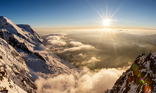 Sunset over the valley of Chamonix, sea of clouds and fog, view from Cosmiques hut, Chamonix, Haute-Savoie, France