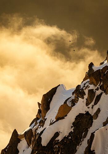 Rocky ridge at sunset, colorful clouds, two birds, Chamonix, Haute-Savoie, France