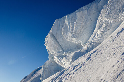 Huge cornice in front of blue sky, Chamonix, Haute-Savoie, France