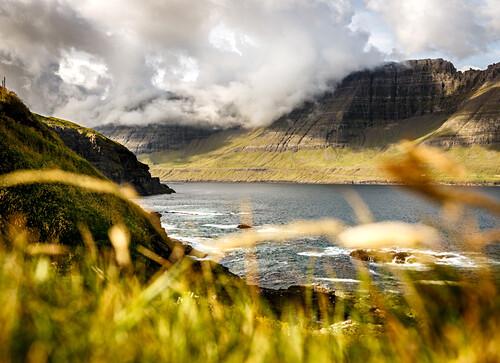 Green, grassy fjord landscape in the north of the Faroe Islands, Viðareiði