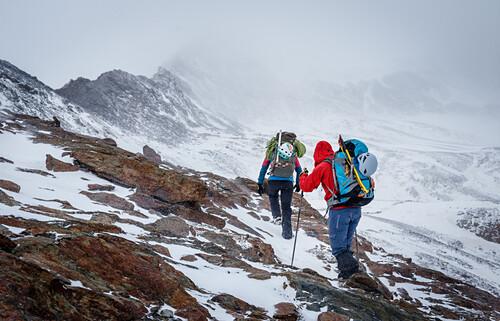 Two alpinists ascent Piz Tresero in heavy snowstorm, Valfurva, Lombardia, South Tyrol, Italy