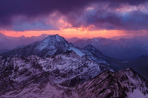 Impressive sunset, snow covered mountain range, view from the bivouc hut at Piz Tresero, Valfurva, Lombardia, South Tyrol, Italy