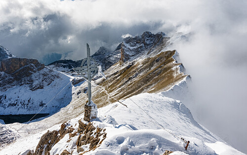Summit of mount Rofanspitze after the first snowfall with mystery clouds, Rofan, Tyrol, Austria