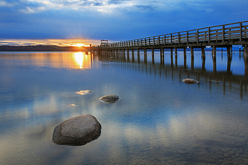 Landing stage at sunrise, lake Ammersee, Bavaria, Germany