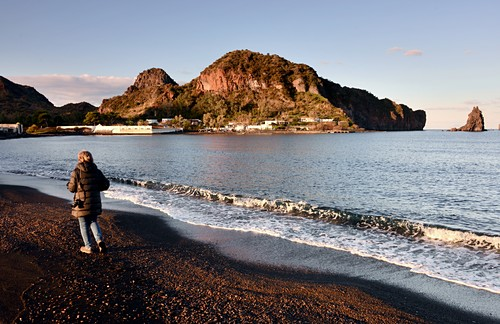 Woman on the beach at Porto Levante on the island of Vulkano, Aeolian Islands, southern Italy