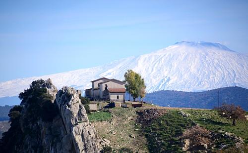 View over a farmhouse to Mount Etna near Enna in the center, Sicily, Italy