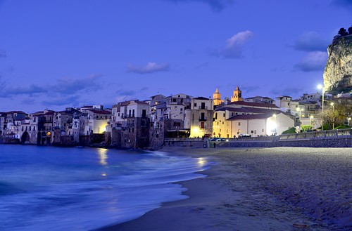 Evening on the beach of Cefalu with its old waterfront houses, north coast, Sicily, Italy