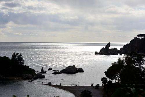 Sea backlit, silhouette, Isola Bella under Taormina, east coast, Sicily, Italy