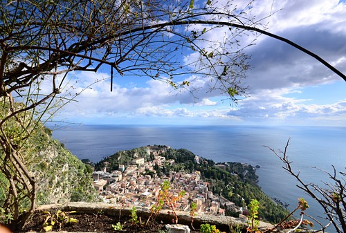 View of Taormina with sea, clouds, small town, east coast, Sicily, Italy