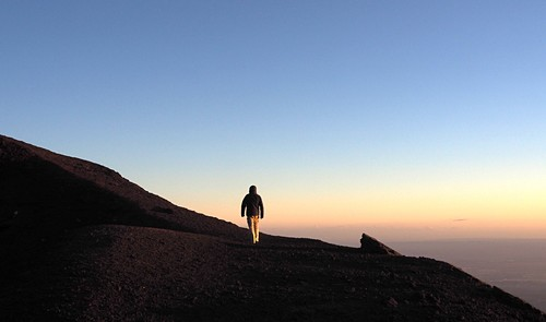 Sunset, man, tourist on Etna volcano, south side, east coast, Sicily, Italy