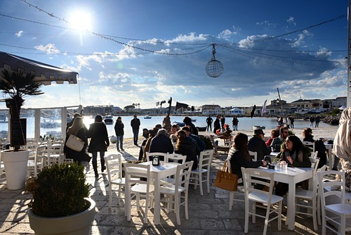 Terrace, restaurant, cafe, harbor in Marzamemi on the Gulf of Noto, southern Sicily, Italy
