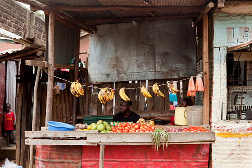 Kenyans at his fruit and vegetable stall in the slum, Eastleigh, Nairobi, Kenya