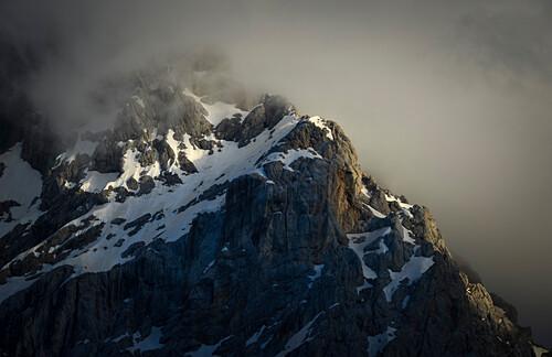 Prisojnik mountain range with clouds at sunset light, snow, Prisanc, from Krnica hut (Dom Krnica), Sava Valley, Vrsi-Pass, Triglav National Park, Julian Alps, Slovenia, Europe