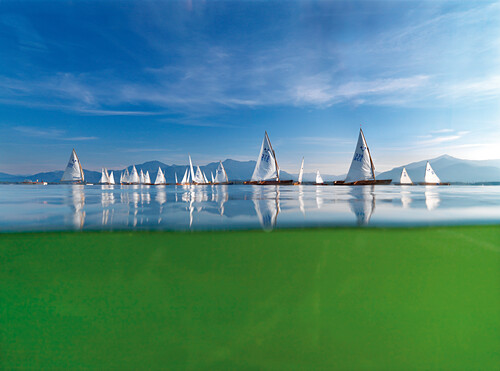 'Sailing Race on Lake Chiemsee, classic wooden sailboats called ''Chiemseeplaetten'', Chiemsee, Bavaria, Germany'