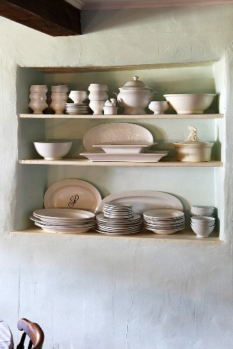Crockery on a shelf in a wall niche