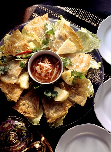 Pieces of rice paper biscuits; Glass plate