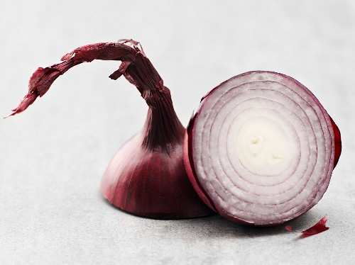 A red onion, halved