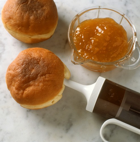 Filling Carnival doughnuts with jam