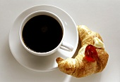 Cup of coffee; Croissant with Jam and Butter