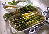 Green asparagus with various sauces