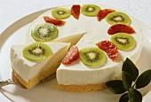 Cream cheesecake with kiwi fruit & blood oranges