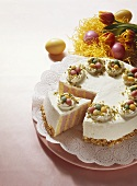 Colourful Easter cake decorated with marzipan eggs