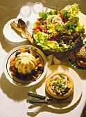 Wholefood meal: semolina, vegetables in sesame ring, salad